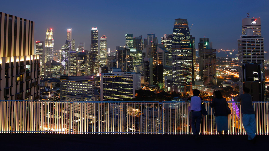 People view the skyline of the central business district in Singapore